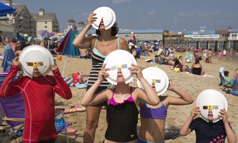 """ECLIPSE WATCHERS ON THE BEACH"""
